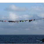 """Varal"", 2005, intervention made with clothes donated by the people of Porquerolles, France, variable dimensions, work conducted 12 times in different cities and countries between 2003 and 2008"