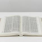 ''Livro Perfurado'',  2013, modified book, Photo Edouard Fraipont