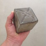 """Primeira Pedra"" engraved concrete, multiple open editions, 7 x 7 x 7 cm, 2014"