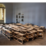 """Printed landscape"", 77 stools with silk screen on plywood, 231x363cm, 77 books recommended by collaborators in the project, Venue for seminar: Rio de Janeiro - ""Past and Present"", 2013. Photograph: Sérgio Araújo."