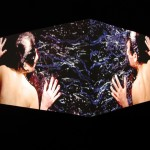 The Kiss | 2004 | 2 channel video installation projected on a 90º corner, 3' loop, no sound