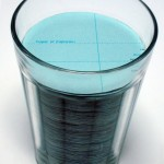 """Glass of water"", 2008, pages of Atlas cut in circle and American glass of water, 9x6.5cm, single edition + A.P."