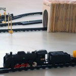 """First Steps"", 2009, electric train and set of books of First Steps collection, 125x210 cm (approx)"