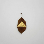 """Masks"", 2012, different plant leaves, gold leaf, variable dimensions."