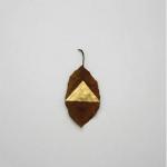 """Masks"", 2012, different plant leaves, gold leaf, variable dimensions."