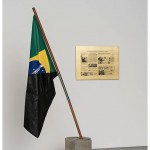 """""""From Abstract Orders to Material Progress II"""", 2010-2013, sculpture, cinder blocks, fabric flag, oil paint, bitumen, copper, wood, stainless steel, cotton cord, 42x100x235 cm (approx.), brass plate engraved in bass relief with automotive painting 60 x 80 cm, Photo by Edouard Fraipont"""