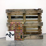 """Tabom"", 2013, wood palette, african fabric and books, 150x150x30 cm"