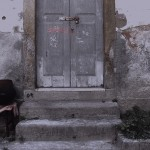 'hymn', performance, 2012, by the rear door of a church, I fill an entire glass of water with saliva.