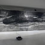 """MEME (Do que se consegue pelas próprias forças) (para Bruno)"" charcoal, collage and wax on paper, wood structure and electric light. Slideshow (40 images), loop. , 2013"