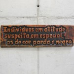 'Individuals in a suspicious attitude especially the one of brown and black color', 2015, notch on wood (eucalyptus) of phrases of institutional racism found in official communications and police reports from the Brazilian Military Police, 30 x 90 x 3 cm, unique edition