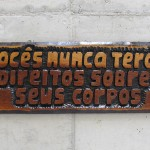 'You will never have the right over their bodies', 2015, notch on wood (eucalipto) of phrases of institutional racism found in official communications and police reports from the Brazilian Military Police, 30 x 80 x 3 cm, unique edition