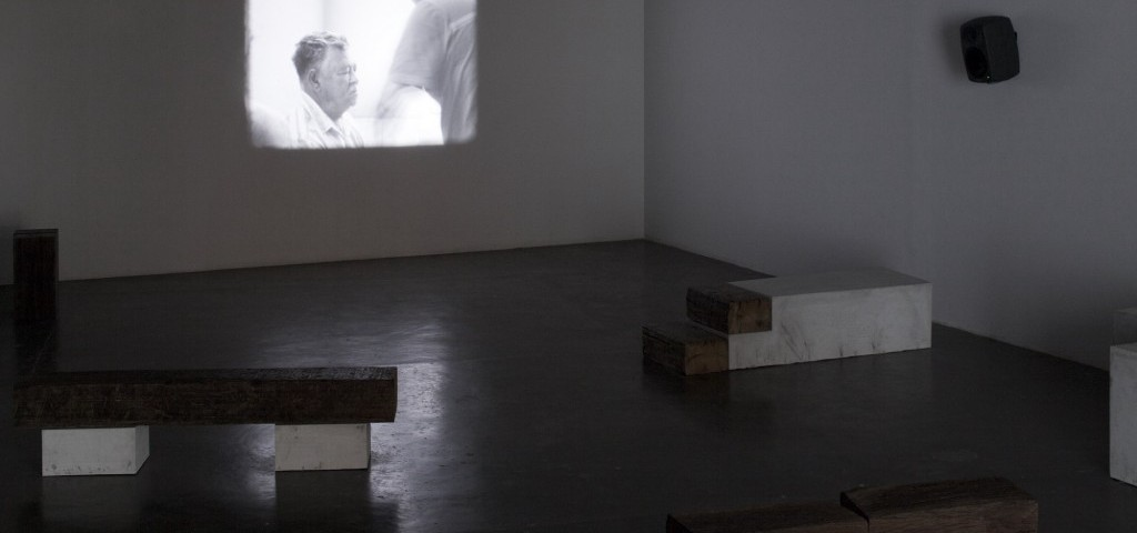 'A Família do Capitão Gervásio' [Captain Gervasio's Family], Tamar Guimarães and Kasper Akhøj, 2013/2014. 16mm film, soundtrack, concrete and reclaimed wood. Installation view, 31st São Paulo Bienial, How to (…) things that don't exist, 2014