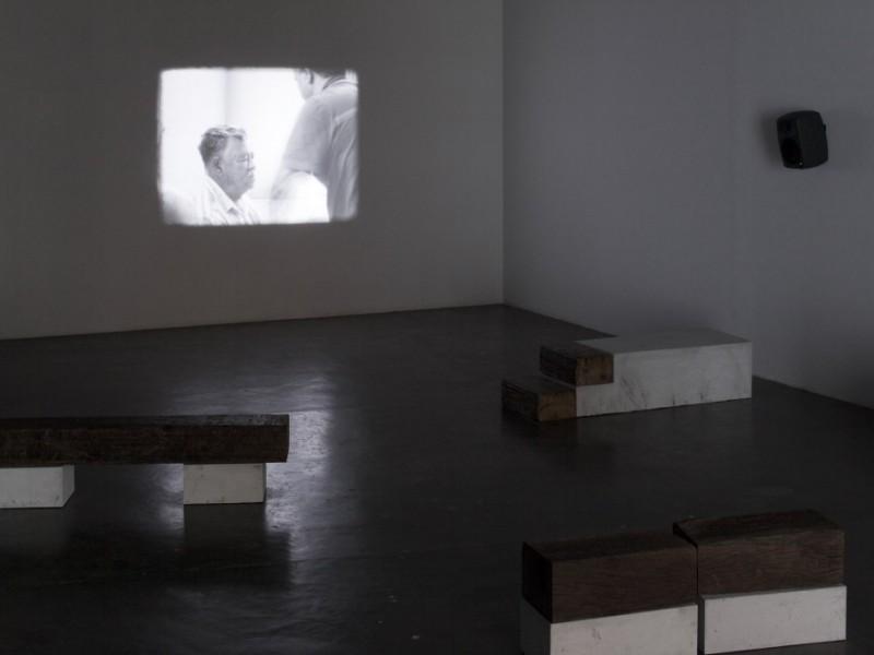 'A Família do Capitão Gervásio' [Captain Gervasio's Family], Tamar Guimarães and Kasper Akhøj, 2013/2014. 16mm film, soundtrack, concrete and reclaimed wood. Installation view, 31st São Paulo Bienial, How to (…) things that don't exist, 2014