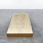 Vanderlei Lopes. Emergence of Mathematics, 2017. Bronze, polished bronze and fiberboard, 27 x 63.2 x 1.2 in (plaque), 1.2 x 1.6 x 1.2 in (stone). Edition of 1 + A.P.